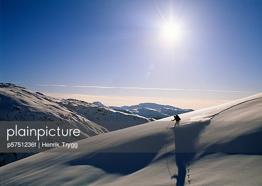 Person skiing on snow-covered mountain - p5751236f by Henrik Trygg