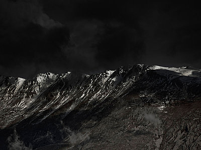 An ominous sky above a mountain range - p301m844081f by Pep Karsten
