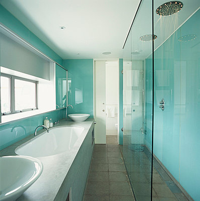 Modern hi-tech pale blue and white bathroom with separate shower room behind glass wall - p3490511 by Jan Baldwin