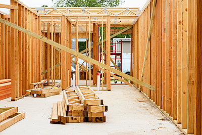 Wooden frame on construction site - p555m1522741 by Roberto Westbrook