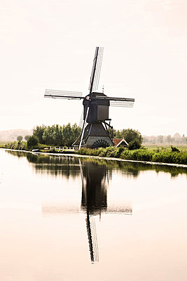 Wind mills next to irrigation canal - p8360036 by Benjamin Rondel