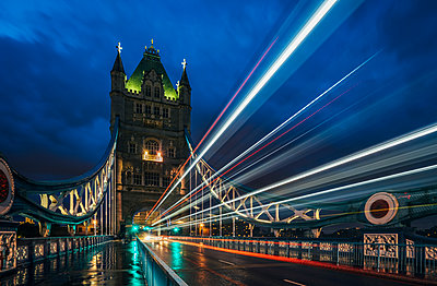 Blurred lights on Tower Bridge at night, London, UK - p1023m2067683 by Anna Wiewiora