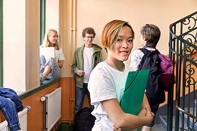 Teenage girl on corridor - p312m2145763 by Susanne Kronholm