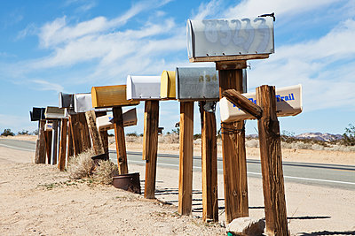 Row Of Mailboxes Along Desert Road - p555m1453605 by Spaces Images