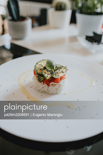 High angle close up of sushi on white plate. - p429m2208591 by Eugenio Marongiu