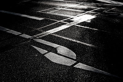Road marking at twilight - p1523m2064369 by Nic Fey