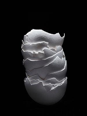Stack of broken eggshell on black background - p301m1498737 by Larry Washburn
