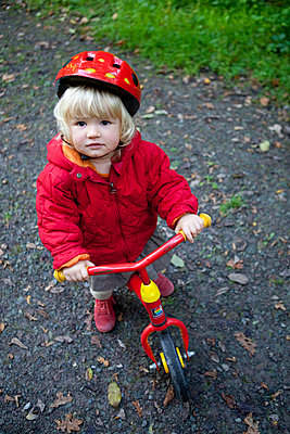 Little girl with bike - p505m951441 by Iris Wolf