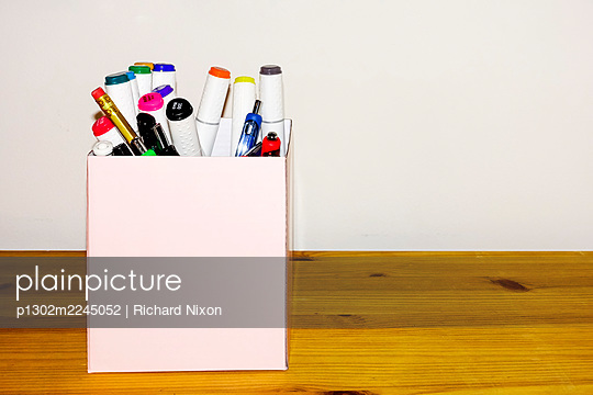 Cardboard box of pens - p1302m2245052 by Richard Nixon