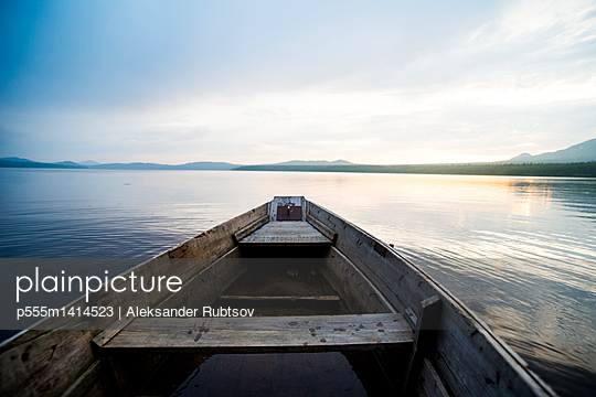 Dilapidated boat on remote lake - p555m1414523 by Aleksander Rubtsov