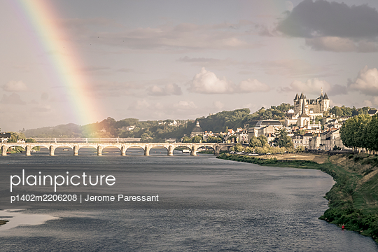 Rainbow over Pont Cessart at Saumur, France - p1402m2206208 by Jerome Paressant
