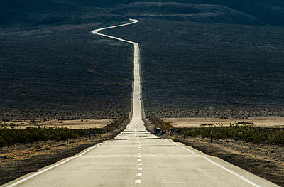 Road amidst landscape in Death Valley National Park - p1166m1193957 by Cavan Images