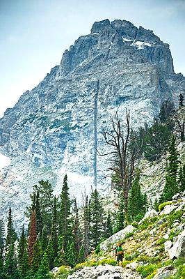 A backpacker going through rocky terrain. - p343m1184705 by Rob Hammer