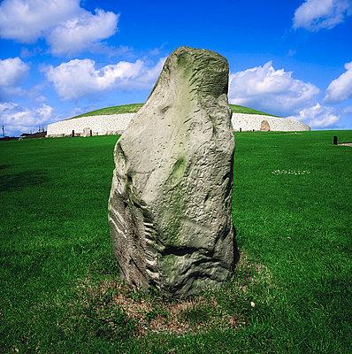 Newgrange,Co Meath,Ireland;Large rock in front of Newgrange - p4428889 by The Irish Image Collection