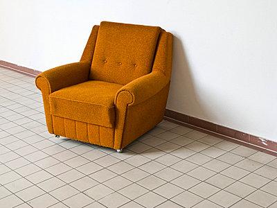 Empty armchair on tiled floor - p4902804 by Jan Mammey