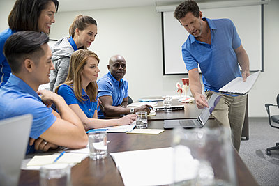 Physiotherapists training at laptop in conference room meeting - p1192m1447334 by Hero Images