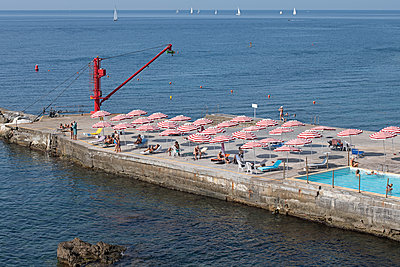Parasols on the pier - p1292m2126969 by Niels Schubert