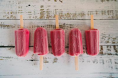 Row of berry ice pops - p1427m2128262 by Alexandra C. Ribeiro