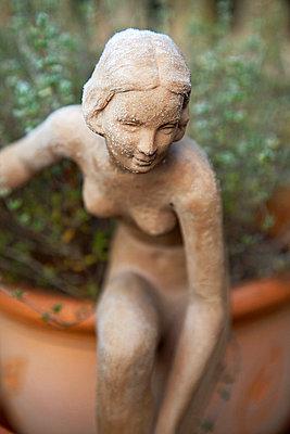 Figure in the garden - p3820195 by Anna Matzen