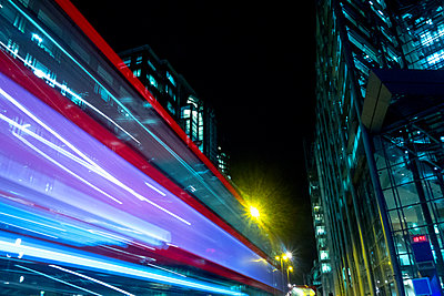 Blurred motion of bus, London, UK - p429m1197922 by Seb Oliver