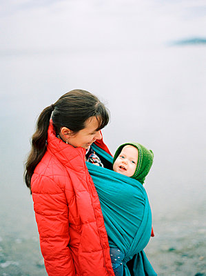 Mother with baby in baby carrier - p343m2026021 by Kirill Bordon