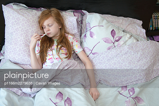 Little Girl Sick in Bed - p1166m2279638 by Cavan Images