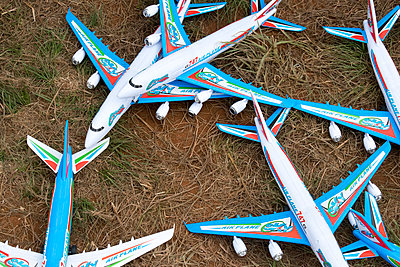 Plastic 747 passenger plane models on the ground - p967m2072623 by Wessel Wessels