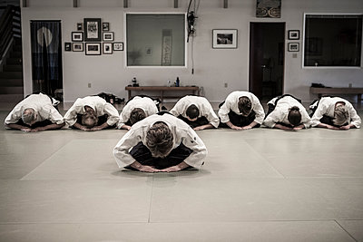 People in martial arts class - p555m1479722 by Adam Crowley