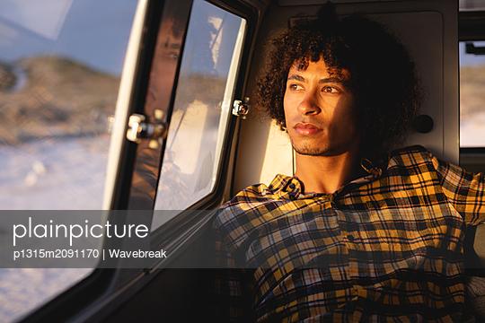 Thoughtful man sitting in a camper van  - p1315m2091170 by Wavebreak