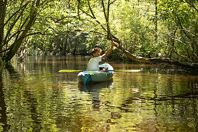Teenage boy in kayak, Econfina Creek, Youngstown, Florida, USA - p924m1422727 by Raphye Alexius