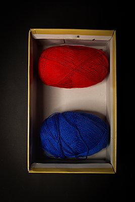 Two wool balls on the box - p1623m2220036 by Donatella Loi