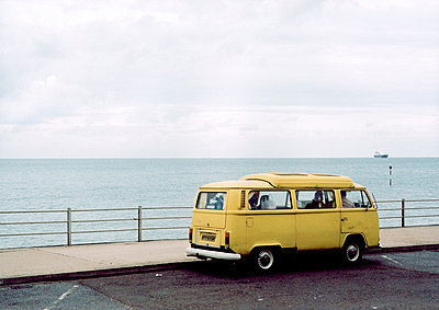 Yellow van parked by sea  - p3012131f by fStop