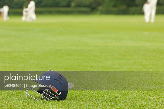 Cricket helmet on a cricket ground
