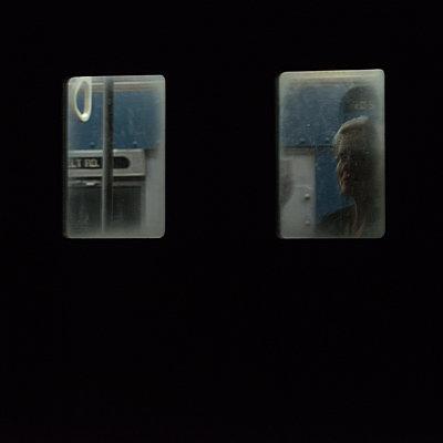 Woman looks through subway window - p1624m2222655 by Gabriela Torres Ruiz