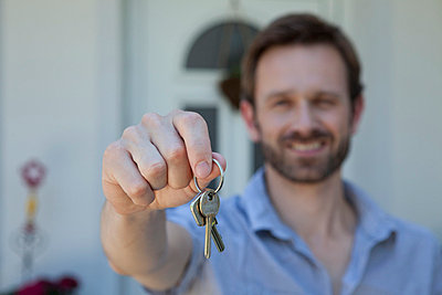 Man offering set of keys - p42914990f by Johnny Valley