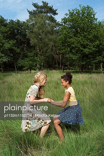 Kids play in the woods - p1132m1152754 by Mischa Keijser