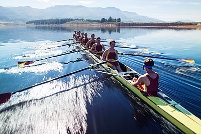 Rowing team rowing scull on lake - p1023m923623f by Chris Ryan