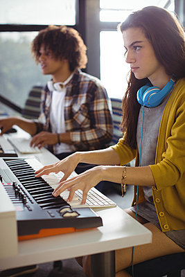 Female sound engineer working in office - p1315m1422214 by Wavebreak