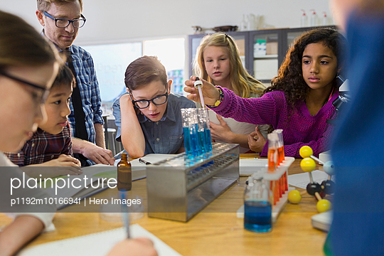 Teacher and elementary students in laboratory - p1192m1016694f by Hero Images