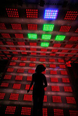 Woman in light room  - p1028m1082453 by Jean Marmeisse