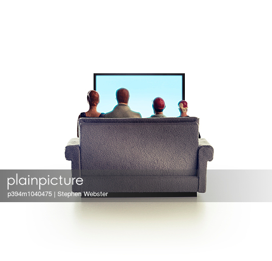 Family watching television - p394m1040475 by Stephen Webster