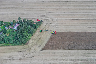 Germany, aerial view of combine harvester at work on a field - p300m1059159f by Patrice von Collani