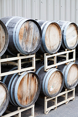Stacked wine barrels at a winery - p301m714315f by Patrick Strattner