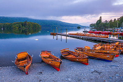 Rowing boats at Windermere at sunset, Lake District National Park, UNESCO World Heritage Site, Cumbria, England, United Kingdom - p871m2046551 by Matthew Williams-Ellis