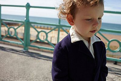 Little boy on promenade - p924m744543f by Emma Kim