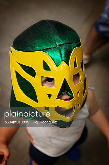 Small Boy Wearing Wrestling Mask