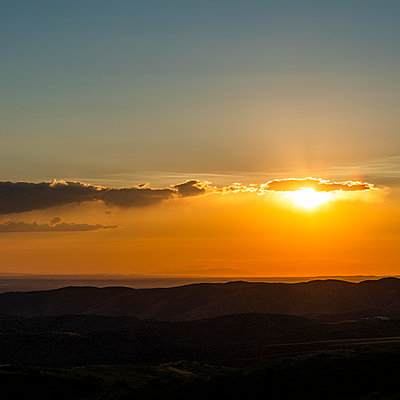 Sunset cloudscape over hills - p1427m2128266 by Steve Smith