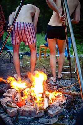 Warm up around the campfire - p1579m2193464 by Alexander Ziegler