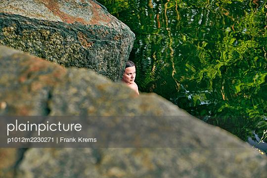 Woman on a rock - p1012m2230271 by Frank Krems
