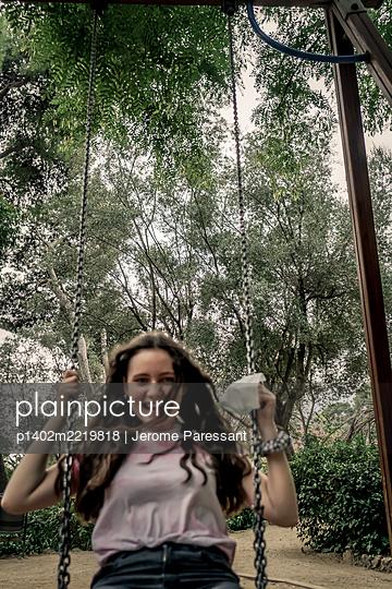 Girl on a swing, portrait - p1402m2219818 by Jerome Paressant